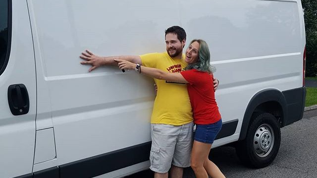 Todd and Kaitlin standing beside Edith (the van).